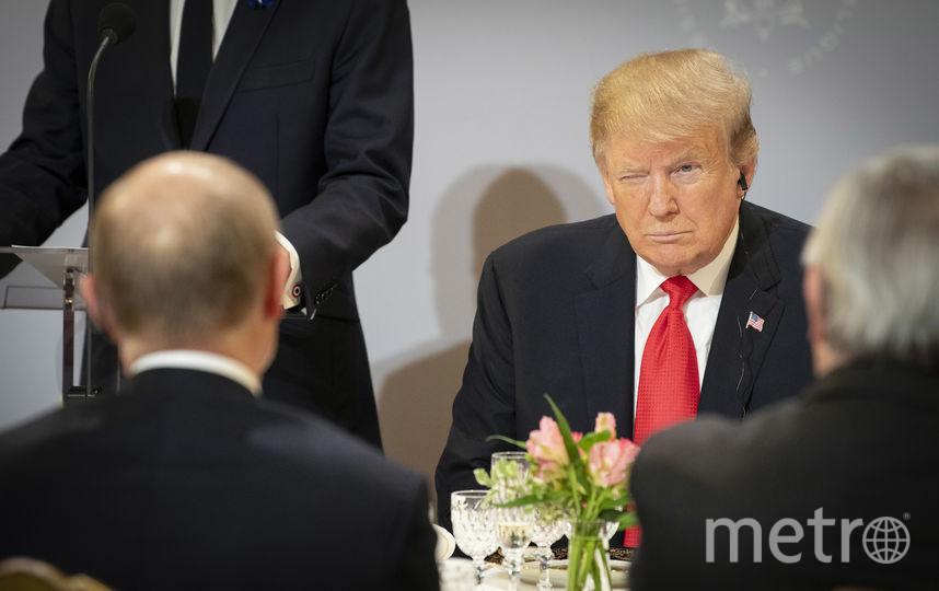 Воскресная церемония во Франции - на ужине Путин и Трамп сидели напротив друг друга. Фото Getty