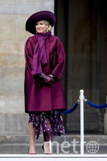 Королева Нидерландов улыбнулась, увидев ушанку на голове гостя из жаркого Сингапура. Фото Getty