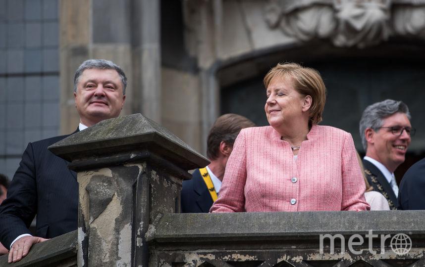 Ангела Меркель и Пётр Порошенко. Фото Getty