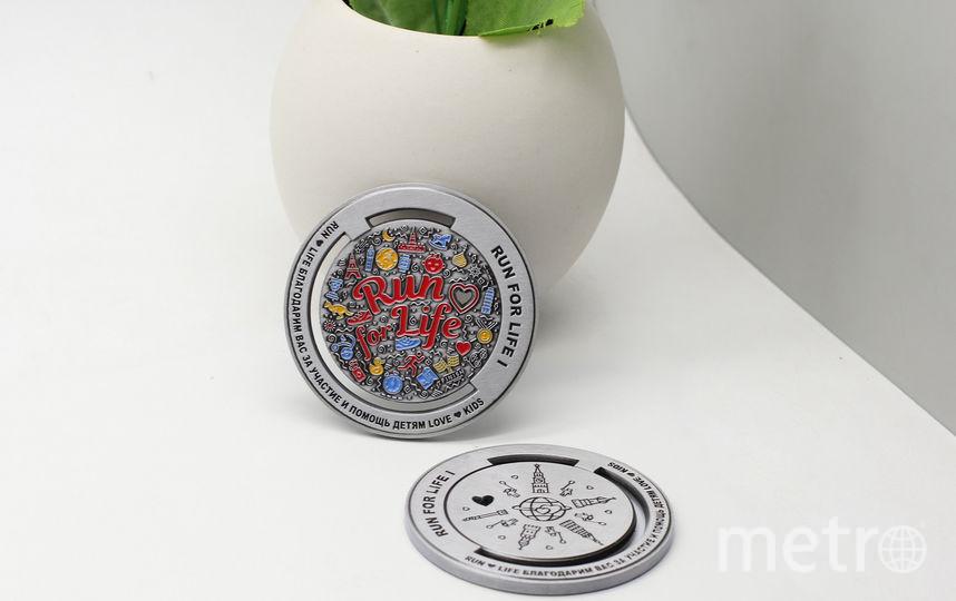 Такие медали получают участники забега. Фото runforlife.ru