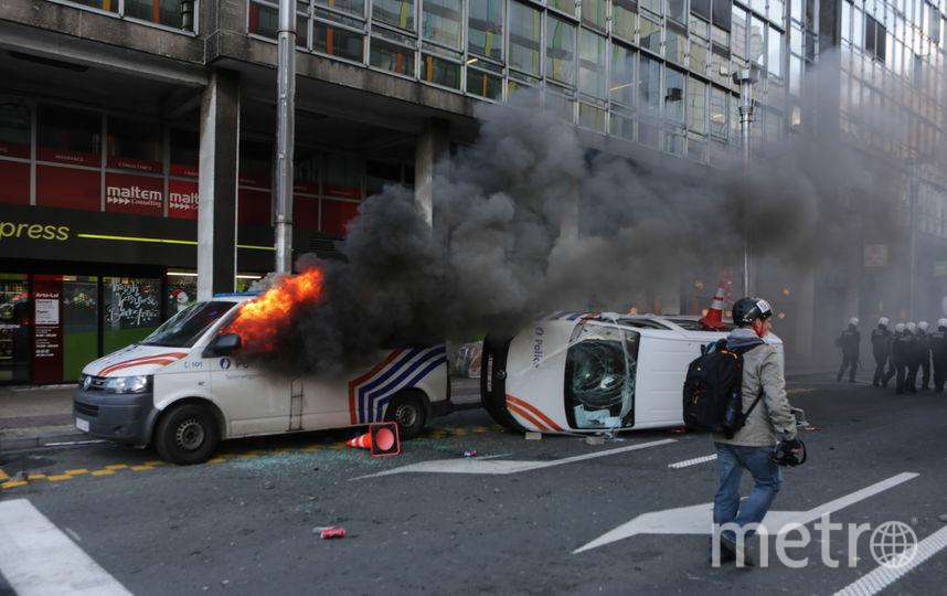 Протесты в минувшую субботу сопровождались погромами и поджогами машин. Фото AFP