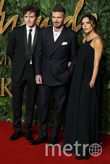Дэвид и Виктория Бекхэм с сыном Бруклином. Фото AFP