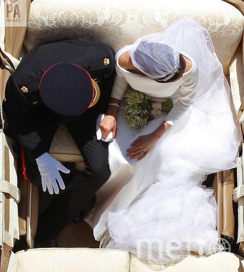 Вот этот кадр со свадьбы Меган Маркл и принца Гарри признан одним из 100 лучших в 2018 году. Фото Getty