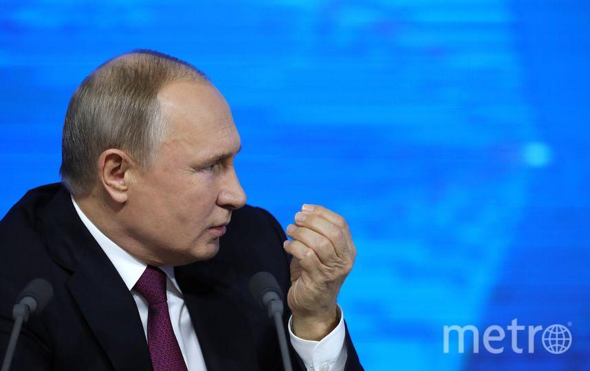 Владимир Путин на большой пресс-конференции для СМИ. Фото AFP