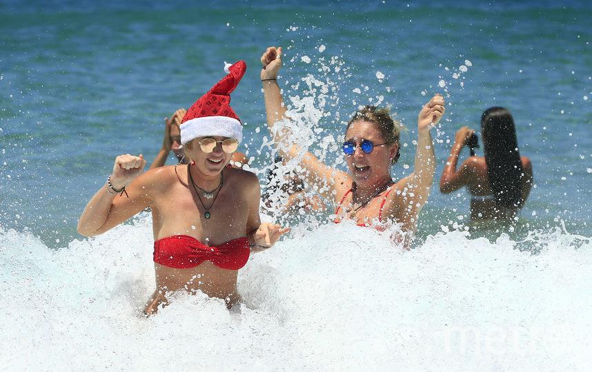 Австралия наслаждается теплом и солнцем. Но тоже отмечает Рождество. Фото Getty