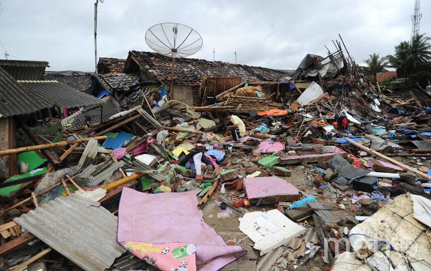 Службы ведут поиски пропавших жертв, но проливные дожди осложняют спасательную операцию. Фото AFP