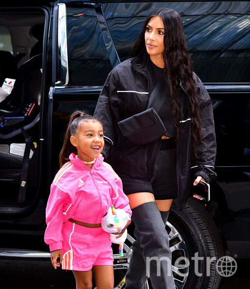 Ким Кардашьян-Уэст с дочерью. Фото Getty