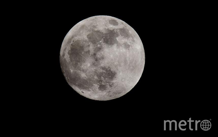Кровавая Луна и затмение. Так выглядело затмение в британском Манчестере. 21 января 2019 года. Фото Getty