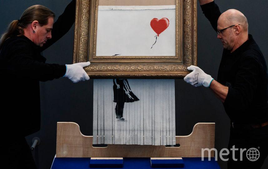 """Картина """"Девочка с воздушным шаром"""" английского уличного художника Бэнкси. Фото Getty"""