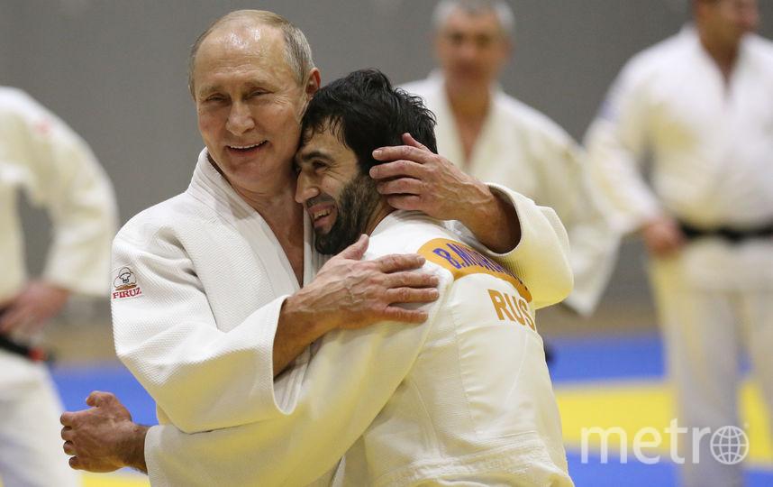 Владимир Путин и Беслан Мудранов. Фото Getty
