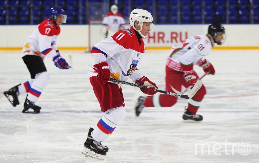 Путин и хоккей. Фото AFP