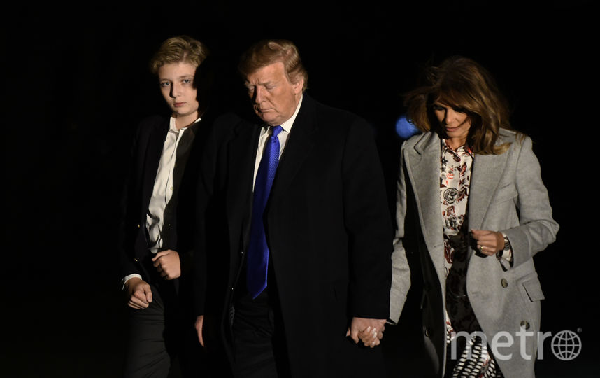 Дональд и Мелания Трамп с сыном Бэрроном. Фото Getty