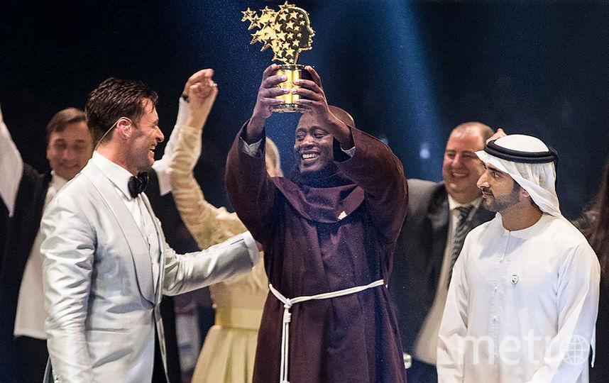 Питер Табичи на церемонии вручения награды. Фото AFP
