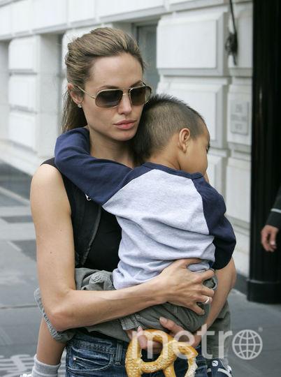 Анджелина Джоли с маленьким Мэддоксом. Фото Getty
