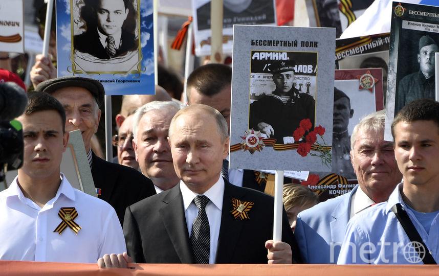 """Владимир Путин на шествии """"Бессмертного полка"""". Фото AFP"""