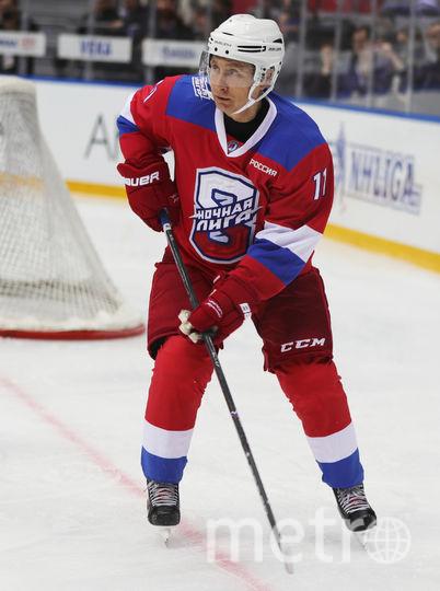 Владимир Путин на хоккейном матче в Сочи. Фото AFP