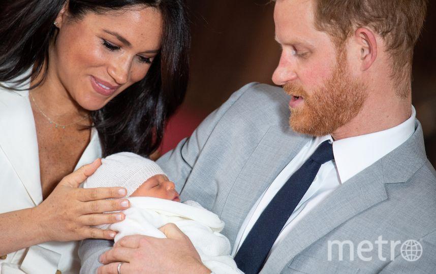Меган Маркл и принц Гарри с сыном. Фото AFP
