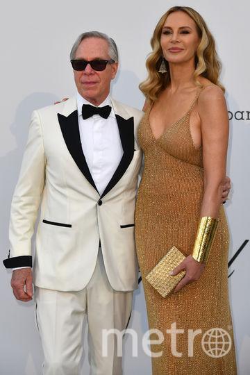 Дизайнер Томми Хилфигер с женой. Фото AFP