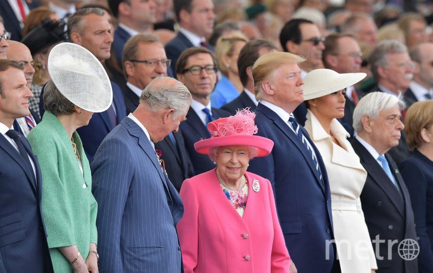 Эммануэль Макрон, Тереза Мэй, принц Чарльз, Елизавета II, Дональд и Мелания Трамп. Фото AFP