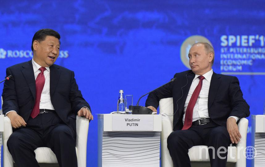 Владимир Путин и Си Цзиньпин в Петербурге. Фото AFP