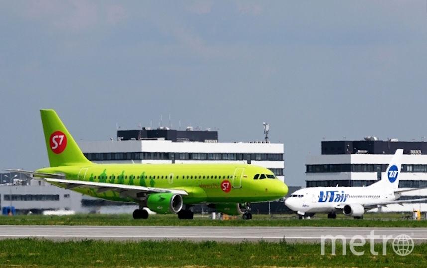 """Самолет Airbus A319-114 авиакомпании """"S7 Airlines"""" на взлётной полосе (архивное фото). Фото РИА Новости"""