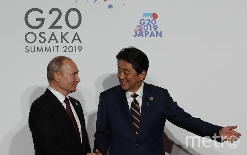 Церемония фотографирования на G20. Путин и Абэ. Фото Getty