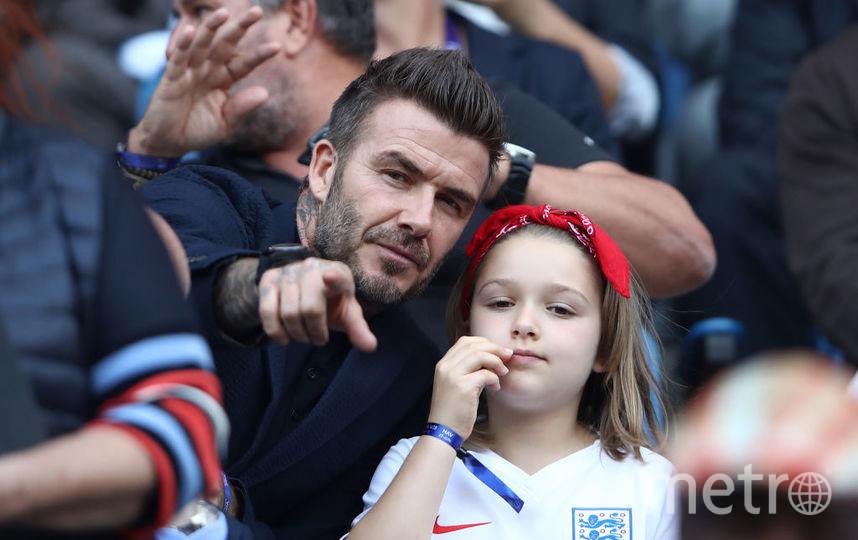 Бекхэм на футболе со своей дочкой Харпер. Фото Getty