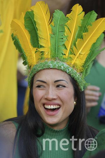Фанатка сборной Бразилии на Кубке Америки. Фото AFP