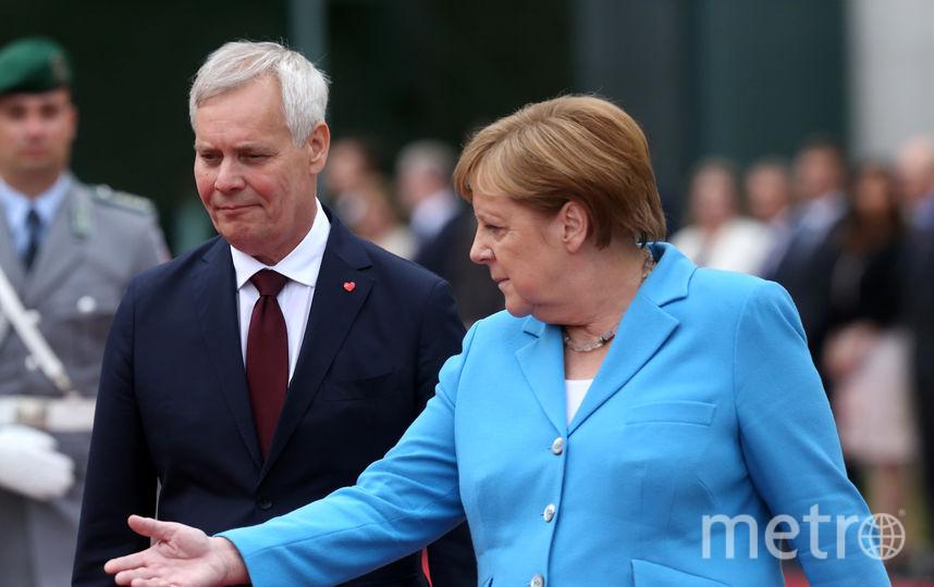 Антти Ринне и Ангела Меркель. Фото Getty