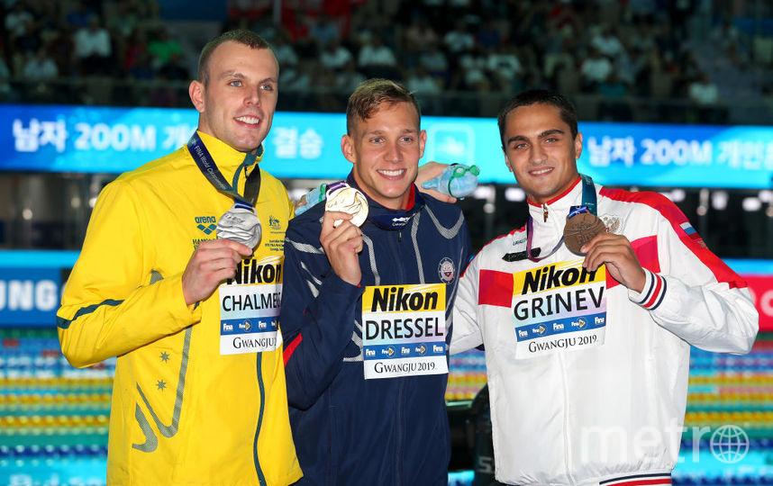 Кайл Челмерс, Калеб Дрессель и Владислав Гринёв после заплыва на 100 метров вольным стилем. Фото Getty