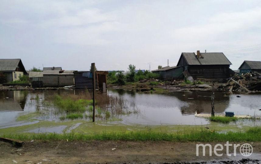 Затопленная улица в городе Тулун в Иркутской области. Фото РИА Новости