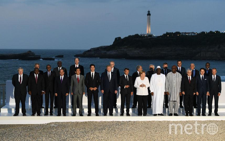 Во время общего фото на саммите G7. Фото Getty