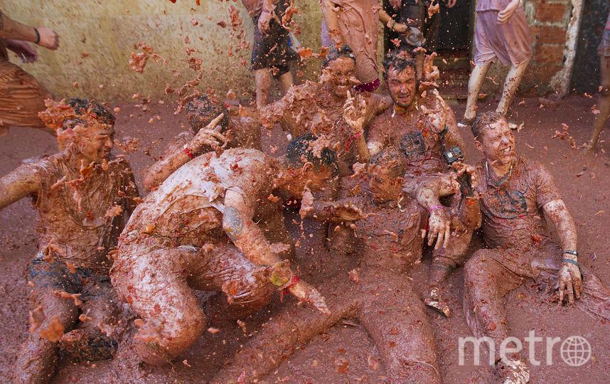 """Всего за время """"битвы"""" было израсходовано 145 тонн помидоров. Фото AFP"""