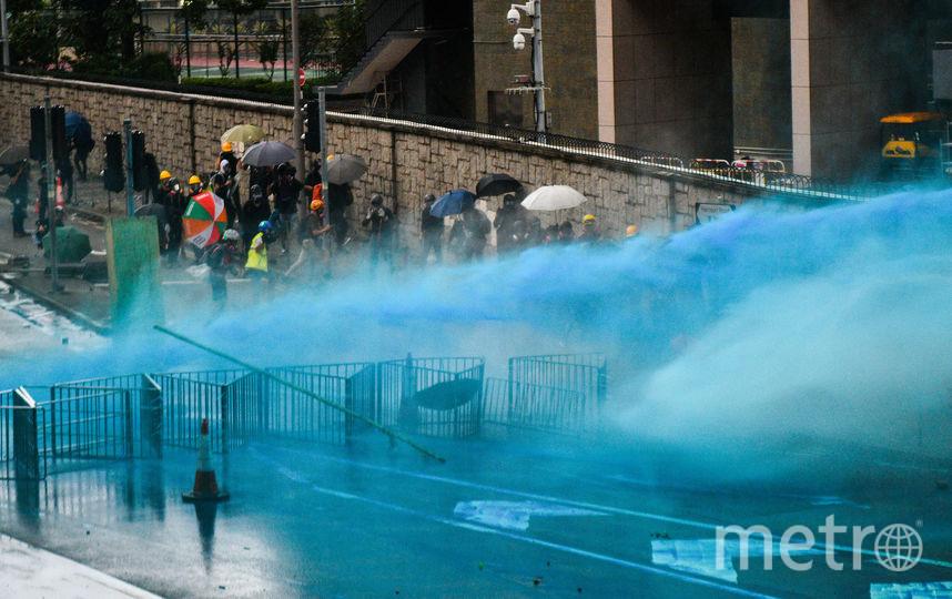 Впервые с начала протестов полицейские использовали синий краситель для маркировки протестующих. Фото AFP