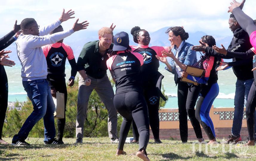 С сёрфингистами на пляже Кейптауна. Фото Getty