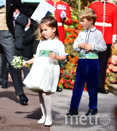 Принц Джордж и принцесса Шарлотта были среди восьми молодых людей, исполнявших роли пажей и подружек невесты. Фото Getty