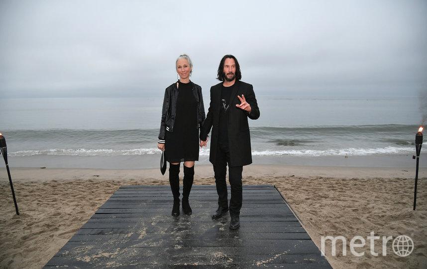Киану Ривз и Александра Грант на показе мужской коллекции Saint Laurent Spring/Summer 2020. Фото Getty