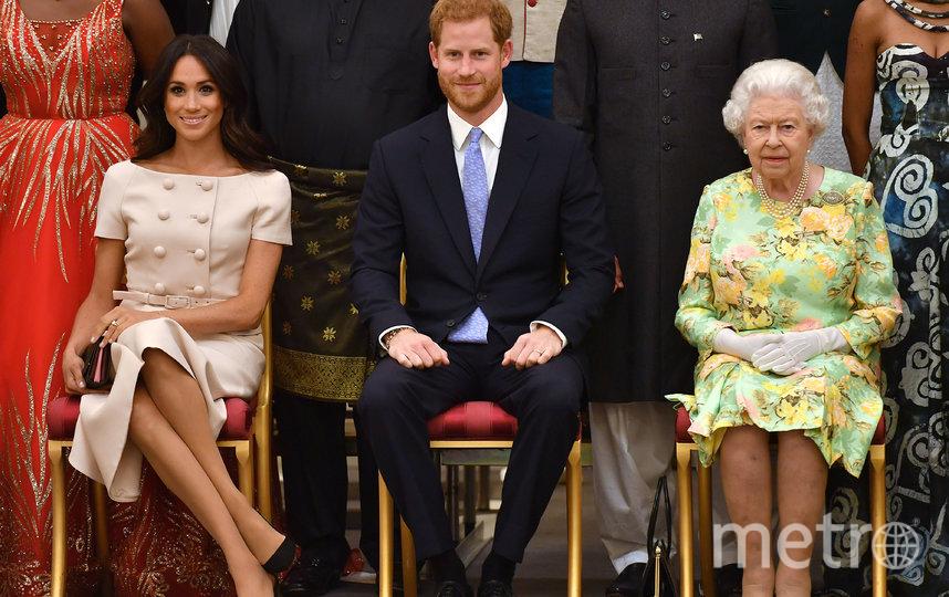 Меган Маркл, принц Гарри и Елизавета II. Фото Getty