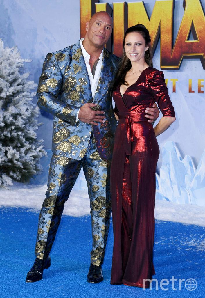 """Премьера """"Джуманджи: Новый уровень"""" в Голливуде. Дуэйн Джонсон с женой. Фото Getty"""