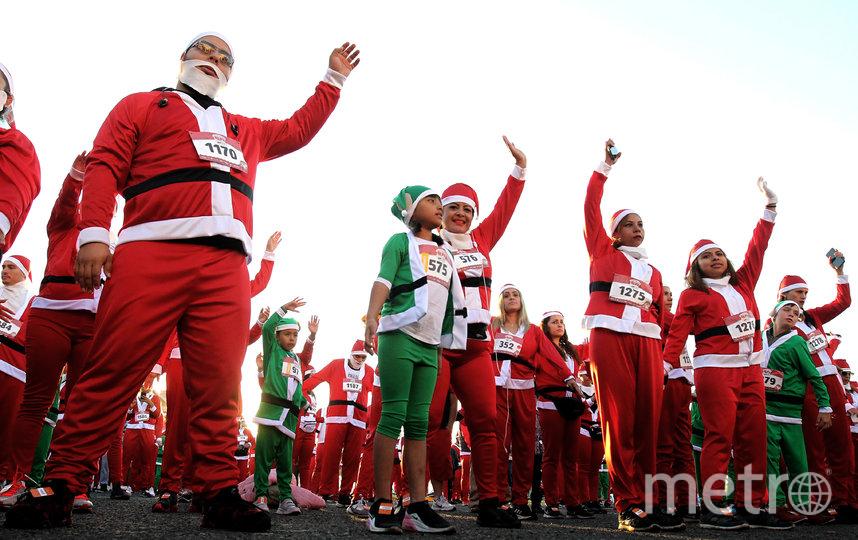 Забег Санта-Клаусов в Гвадалахаре, Мексика. Фото AFP