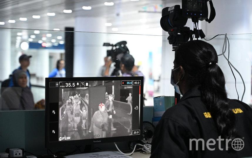 Процедура сканирования в Куала-Лумпуре, Малайзия. Фото AFP