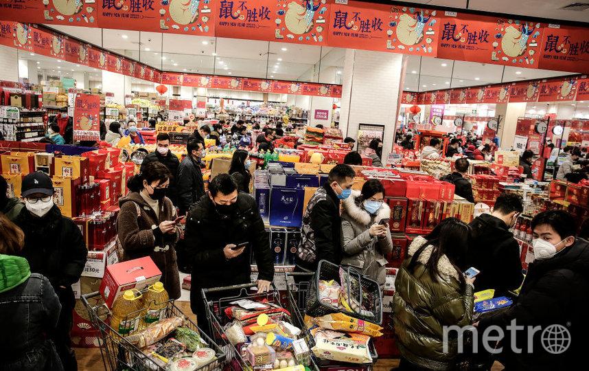 Жители города Ухань скупают в магазинах запасы продуктов. Фото Getty