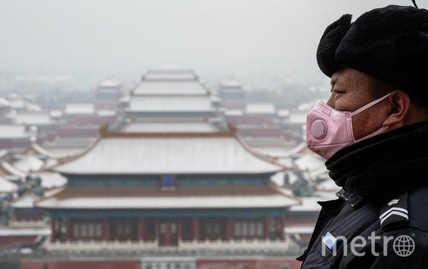 В Китае по-прежнему повышенные меры безопасности в связи с ситуацией в Ухане. Фото AFP
