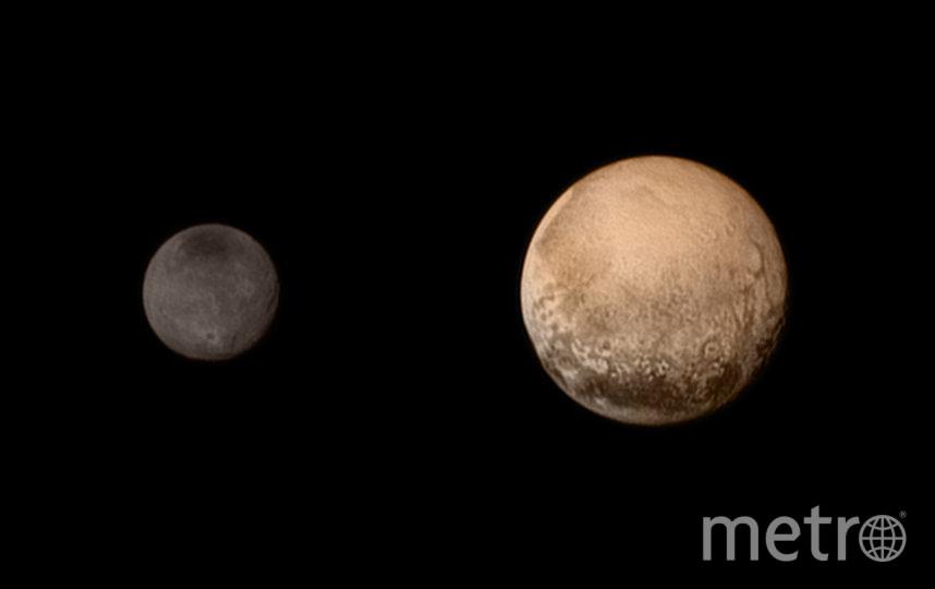 """Плутон (справа) и один из его спутников – Харон (слева). Фото сделано станцией """"Новые горизонты"""". Фото Getty"""