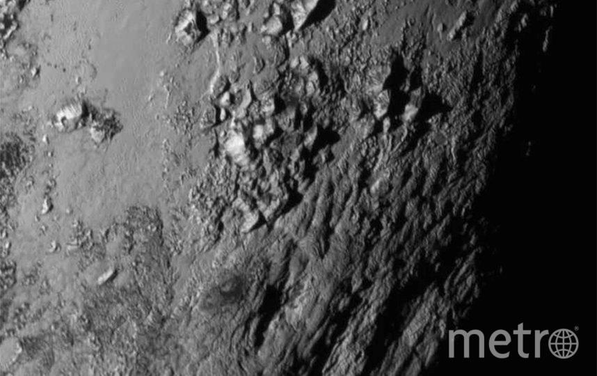 Детальная фотография поверхности Плутона, сделанная с расстояния 12 555 км. Фото Getty