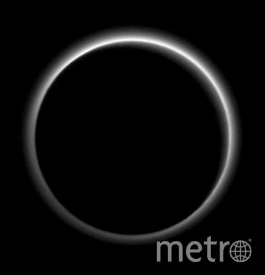 Солнечное затмение. На снимке видна атмосфера Плутона. Фото Getty