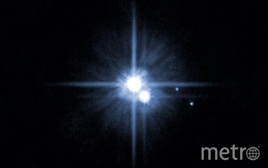 """Плутон со своими спутниками Хароном, Никтой и Гидрой. Фото сделано телескопом """"Хаббл"""". Фото Getty"""