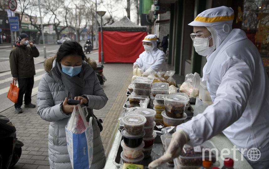 Жители Пекина. Фото AFP