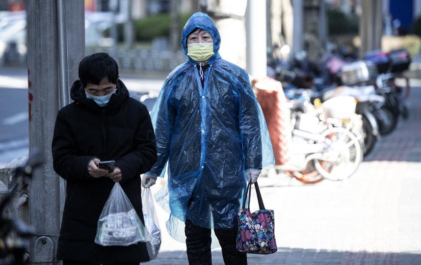 Жители Шанхая. Фото AFP