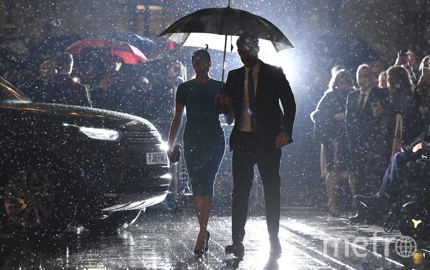 Вечер в столице Великобритании выдался дождливым. Фото AFP